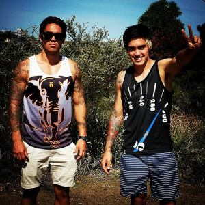 Len Pearce from Justice Crew wearing the King of the Jungle singlet and the Speedometer singlet.